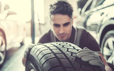 BMW Mechanic Checking Tire
