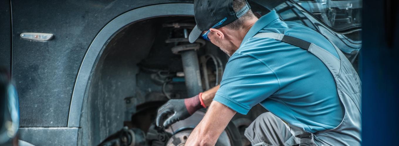 Mechanic Checking Car Tire