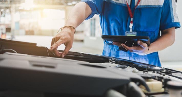 BMW Mechanic Checking Engine Issue